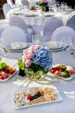 Banquet round table for guests Royalty Free Stock Photography