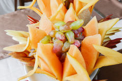 Banquet sliced fruit on a plate dessert restaurant Royalty Free Stock Image