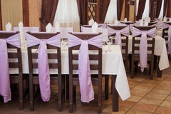 Banquet, stand tables. Banquet, stand in a row covered tables Royalty Free Stock Images