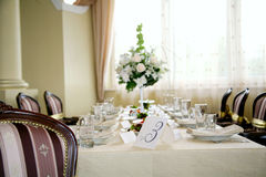 Banquet table. Elegant tables and chairs set up for a wedding banquet Royalty Free Stock Images
