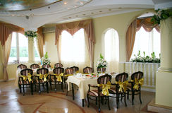 Banquet table. Elegant tables and chairs set up for a wedding banquet Stock Images