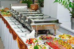 Banquet table. With chafing dish heaters and canapes stock image