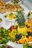 Banquet table. Richly served and decorated banquet table with plenty of food Stock Photo