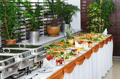 Banquet table. With chafing dish heaters and canapes Stock Photography