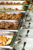Banquet table. With chafing dish heaters Stock Photo