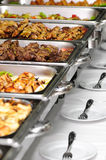 Banquet table. With chafing dish heaters Stock Images