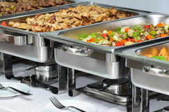 Banquet table. With chafing dish heaters royalty free stock photos