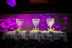 Banquet table. Beautiful spent banquet table decoration Purple background Stock Image