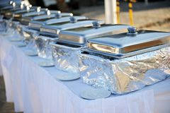Banquet table with chafing dishes Royalty Free Stock Photo