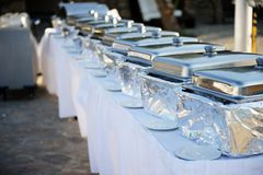 Banquet table with chafing dishes Stock Photos
