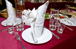 Banquet table. Decorated with a vinous tablecloth for a celebration Stock Image
