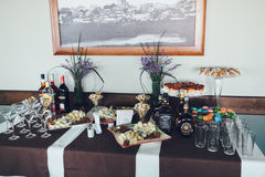 Banquet table with different snacks and alcohol Royalty Free Stock Photo