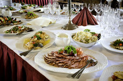 Banquet Table Food. A large table filled with assorted foods ready for a banquet royalty free stock photo