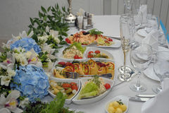 Banquet Table Food. A large table filled with assorted foods ready for a banquet Royalty Free Stock Images