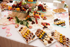 Banquet table full of sweets, fruits and berries Royalty Free Stock Photo