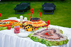 Banquet table with hearts of fruit and sausage Royalty Free Stock Image