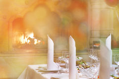 Banquet table near the fireplace Royalty Free Stock Photo