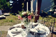 Banquet table. Outdoor covered with a white tablecloth a banquet table Royalty Free Stock Image