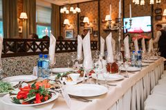 The banquet table in the restaurant is fully reserved and snacks are on display. Photo of The banquet table in the restaurant is fully reserved and snacks are stock photography