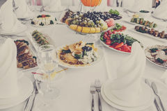Banquet Table in restaurant served with different meals. Stock Images