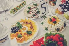 Banquet Table in restaurant served with different meals. Royalty Free Stock Photos