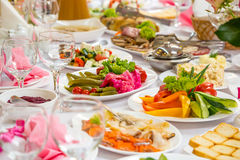 Banquet Table in restaurant served with different meals. Royalty Free Stock Photo