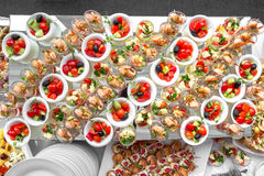 Banquet Table in restaurant served with different meals. Ready for wedding reception Stock Photography