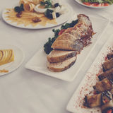 Banquet Table in restaurant served with different meals. Royalty Free Stock Photography