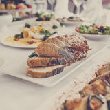 Banquet Table in restaurant served with different meals. Royalty Free Stock Image