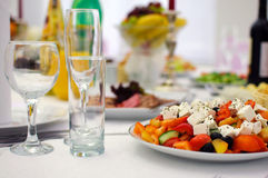Banquet table. Serving dishes. Banquet table. Festive table setting.  Serving dishes. The food in the restaurant. Wedding evening. The peoples kitchen. A range Royalty Free Stock Image