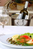 Banquet table setting. Salad, a fish Royalty Free Stock Photo
