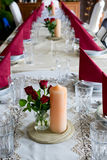 Banquet table setting themed with roses Stock Photos