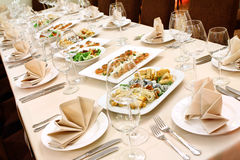 Banquet table with snacks Stock Photos