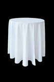 Banquet table with white tablecloth. Isolated on black Royalty Free Stock Photos