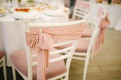 Banquet wedding chairs setting on evening reception Stock Image