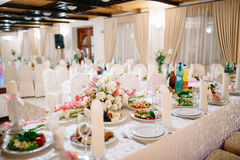 Banquet wedding table setting on evening reception Stock Photo