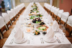 Banquet wedding table setting on evening reception Royalty Free Stock Image
