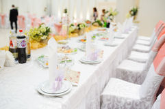 Banquet wedding table setting on evening reception Stock Image
