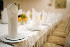Banquet wedding table setting on evening reception Royalty Free Stock Photos
