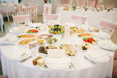 Banquet wedding table setting on evening reception Royalty Free Stock Photo