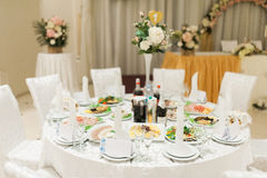 Banquet wedding table setting on evening reception Stock Images