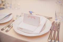 Banquet wedding table setting on evening reception Stock Photos