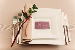 Banquet wedding table setting evening reception name card. Banquet wedding table setting on evening reception with name card clous up Royalty Free Stock Images