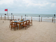 Banquet. Windy beach and a meal Royalty Free Stock Image
