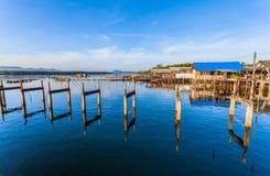 The broken pier at Bansamchong fishing village in Phang Nga province. Stock Photos