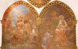 Banska Bela - freskomålningen av tillbedjan av herdeplatsen i St John evangelistkyrkan av Jan Antal (1905) Royaltyfri Fotografi