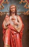 Banska Bela - o coração da estátua de Jesus Christ de St John a igreja do evangelista de um fim de 19 centavo por artista desconh imagens de stock