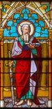 Banska Bela - Sten Pautl aposteln på fönsterrutan av St John evangelistkyrkan från slut av 19 cent Arkivfoto