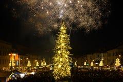 New Year`s Eve firework. BANSKA BYSTRICA, SLOVAKIA - JANUARY 1, 2017: New Year`s Eve firework behind Christmas tree. Celebrating 2017 in Banska Bystrica Royalty Free Stock Photo