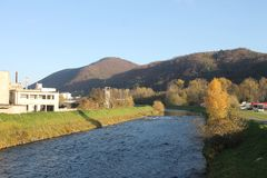 Hron river  and autumn mountainsin Banska Bystrica royalty free stock photo